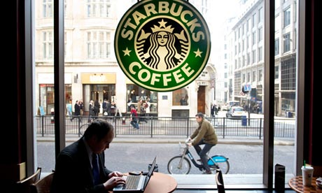 City worker on laptop in Starbucks coffee shop Monument London. Photo:Jeff Gilbert